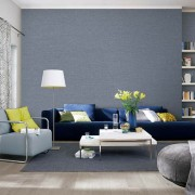View of living room in grey, yellow and blue with picture on wall